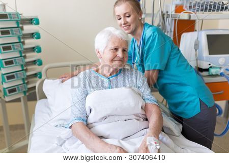 Senior patient and nurse in hospital