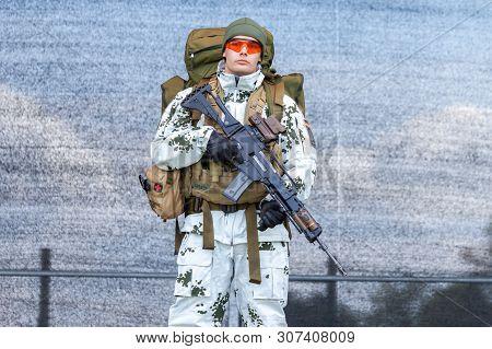Augustdorf / Germany - June 15, 2019: German Mountain Trooper In Snow Camouflage Suit Walks On A Sta