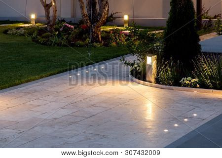 Marble Tile Playground In The Backyard Of Flowerbeds And Lawn With Ground Lantern And Lighting In Th
