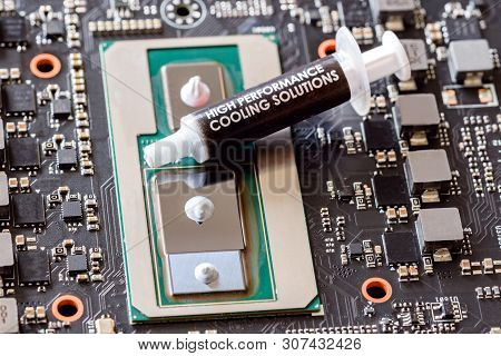 Applying Thermal Grease To Cpu Closeup Modern Processor