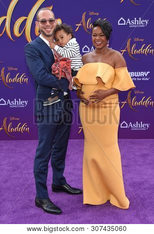 LOS ANGELES - MAY 21:  Vaughn Rasberry, Edward Rasberry and Tatyana Ali arrives for the 'Aladdin' World Premiere on May 21, 2019 in Hollywood, CA