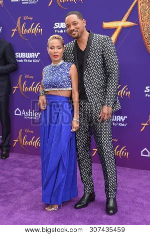LOS ANGELES - MAY 21:  Jada Pinkett Smith and Will Smith arrives for the 'Aladdin' World Premiere on May 21, 2019 in Hollywood, CA