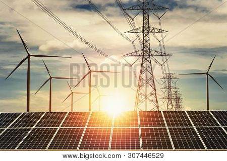 Electricity Power In Nature. Clean Energy Concept. Solar Panel With Turbine And Tower Hight Voltage