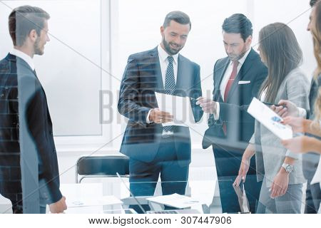 group of business people discussing business documents