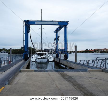 A Sailing Catamaran Preparing For Lift Out By The Gold Coast Marine Centre Boat Travel Lift. Gold Co