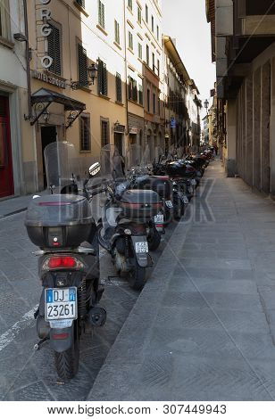 Florence/italy- April 6, 2018: A Rank Of Scooters Lined Up Along A Side Street.