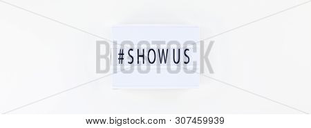 Creative Top View Flat Lay Of Lightbox With Hashtag Show Us Message White Background Minimal Style.