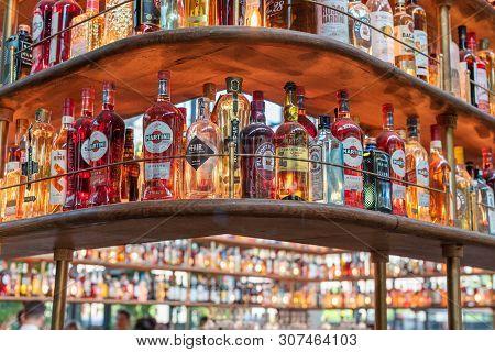 Paris, France - April 15, 2019 : Large Collection Of Alcohol Bottles On Shelves In La Felicita Bar-r