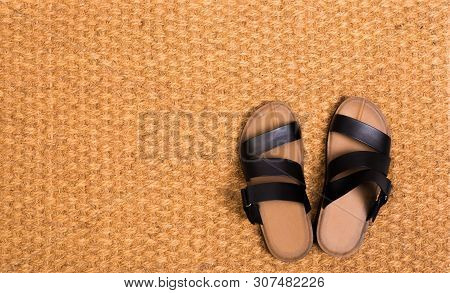 Cleaning foot carpet with sandals welcome home  - Image poster