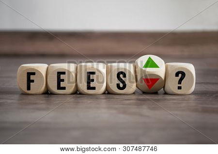Cubes And Dice With Fees Arrows Up And Down On Wooden Background