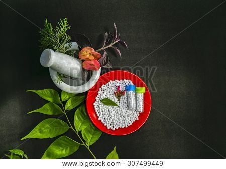 Homeopathic Medicine Concept - Top View Of Scattered Homeopathic Sugar Pills In A Red Plate With Gre