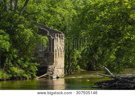 Grist Mill Ruins By A River In The Woods