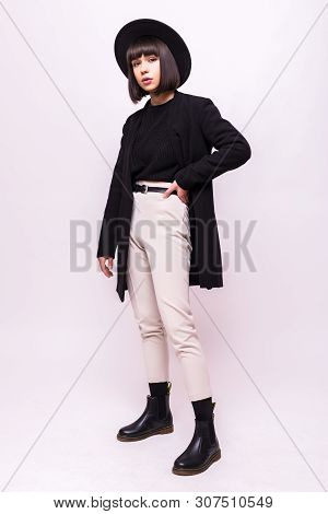 Fashion Full Portrait Of A Young Woman In Black Clothing Isolated On White Background