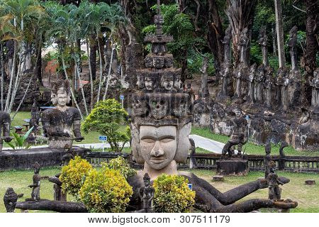 poster of Buddha statues at the beautiful and bizarre buddha park in Vientiane, Laos.