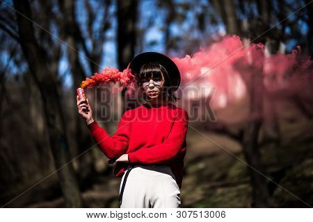 Attractive Woman With A Colorful Smoke Cloud Grenade Bomb Fashion Glitter Outdoors