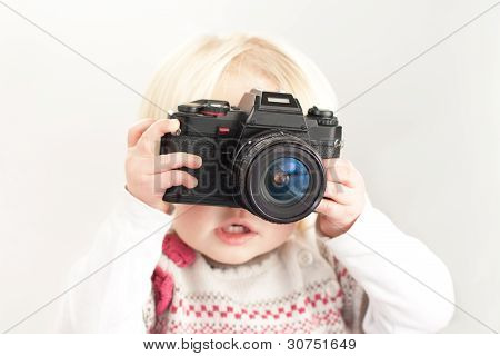 Child holding a camera