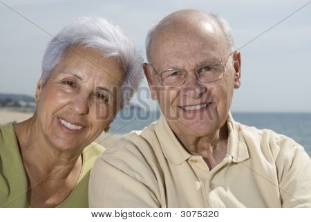 Senior Smiling Couple At The Beach