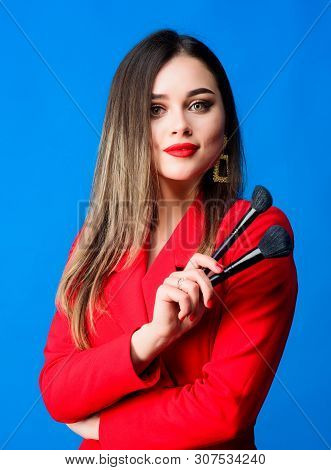 Gorgeous lady makeup red lips. Attractive woman applying makeup brush. Strengthen confidence with bright makeup. Perfect skin tone. Makeup artist concept. Looking good and feeling confident poster