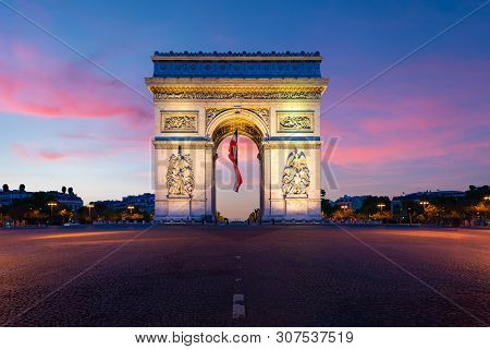 Arc De Triomphe De Paris At Night In Paris, France.