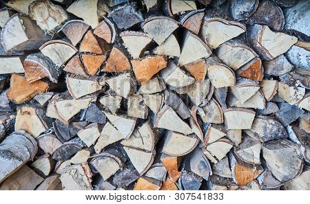 impaled firewood lies in a woodpile texture poster