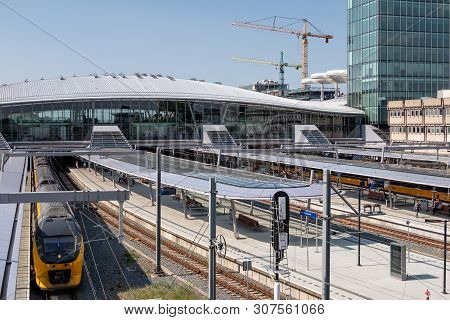 Utrecht, The Netherlands - May 15, 2018: Railway Station Utrecht With Waiting Trains And Travelers