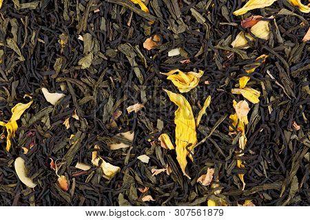 Autumn Extravaganza Tea. Mix Of Ceylon Black Tea, Sencha, Sunflower, Rose, Almond Flakes.