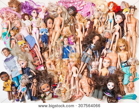 Moscow, Russia - June 17, 2019: Top View Of Various Used Fashion Dolls ( Barbie, Ken, Shelly, Chelse