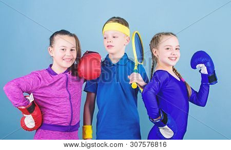 Great Progress. Happy Children In Boxing Gloves With Tennis Racket And Ball. Fitness Energy Health.