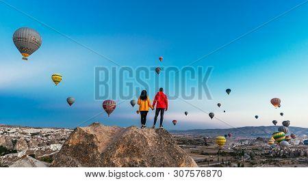 Turkey, Cappadocia - October 10, 2018: Couple In Love Among Balloons. Happy Couple In Cappadocia. Ho