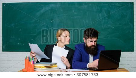 Annual report. Teacher and supervisor working together in school classroom. School educator with laptop and principal with documents. Educational program. School education. Prepare for school lesson poster