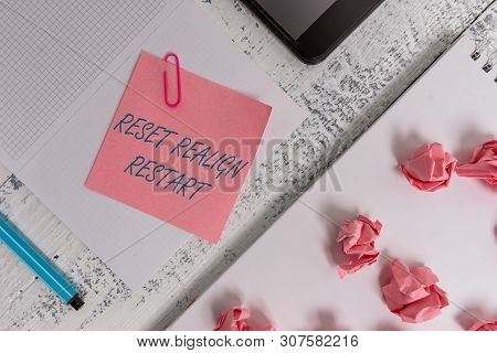 Text sign showing Reset Realign Restart. Conceptual photo Life audit will help you put things in perspectives Squared spiral notebook marker smartphone paper balls note clip wooden. poster