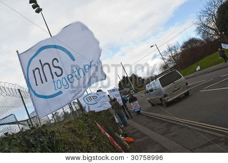 EXETER - MARCH 7:  An NHS Together flag flaps in the wind on Barrack Road in Exeter, during the NHS reform protest outside the Royal Devon & Exeter Hospital on March 7, 2012 in Exeter, UK poster