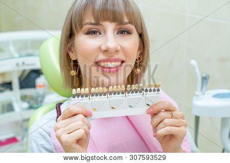Happy Woman Customer In Dentistry , Teeth Whitening.
