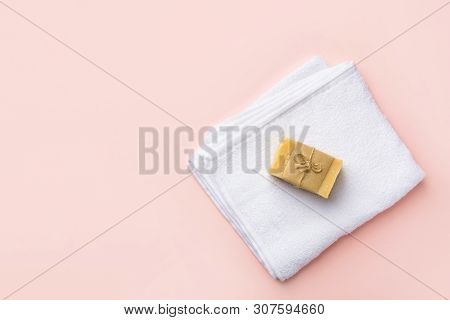 Folded Clean White Fluffy Terry Towel Artisan Handmade Marseille Soap On Pastel Pink Background. Min