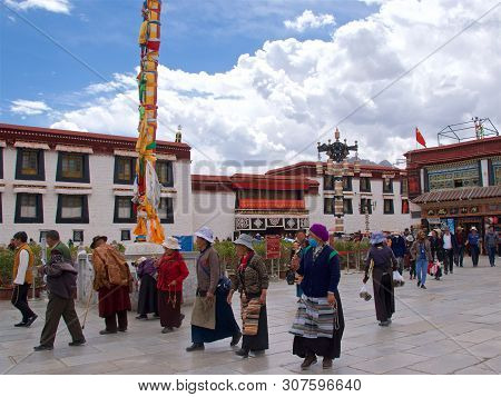 Tibet, China - May 2019: Tibetan People Made Their Pilgrimage To The Holy Place In Lhasa, Tibet