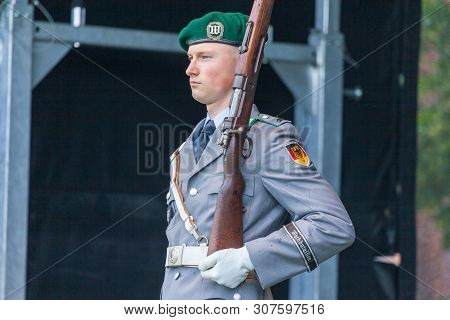 Augustdorf / Germany - June 15, 2019: German Soldier From The Guard Battalion Walks On A Stage At Da