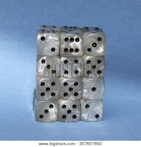 A Stack Of Dice Used For Gambling With A Blue Background.