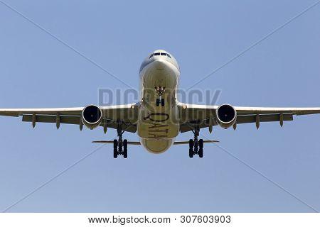 Borispol, Ukraine - May 18, 2019: A7-aeg Qatar Airways Airbus A330-300 Aircraft On The Blue Sky Back