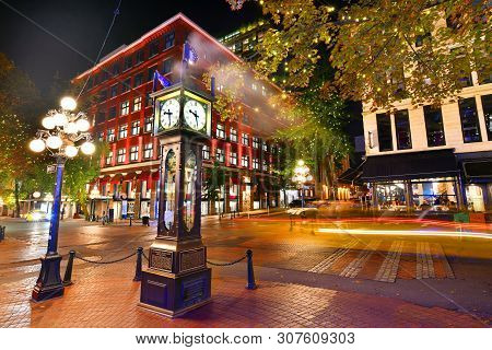 poster of Night view of Historic Steam Clock in Gastown Vancouver,British Columbia, Canada