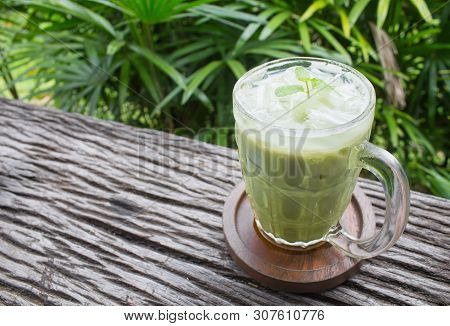 Cold Green Tea Milk Beverage Or Cold Drinks Right Frame Crosswise View. Green Cold Drinks And Ice On