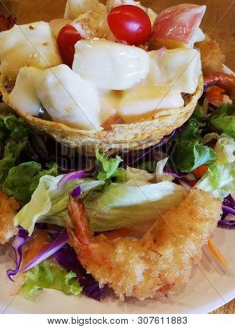 Salad With Fried Shrimp On Dish