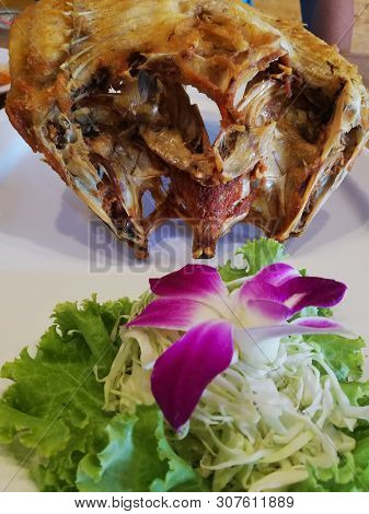 Deep Fried Snapper With With Lettuce And Orchid Flower On Dish