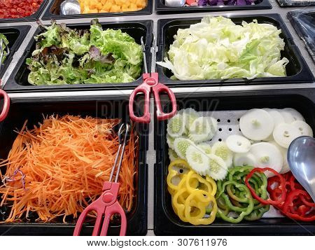 Freshly Cut Vegetables Are Lined Up In A Tray As A Vegetable Salad In The Supermarket
