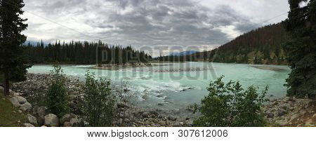 Athabasca River, Jasper National Park. Traveling In Canada. Panorama Of A Beautiful Place. View From