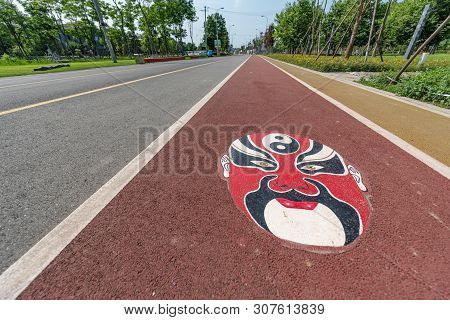 Chengdu, Sichuan Province, China - June 5, 2019 : Greenway With Sichuan Opera Mask Drawing In The In
