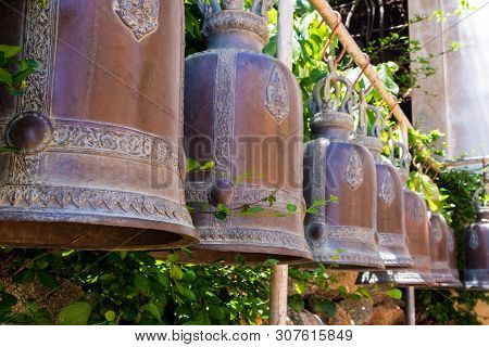 Hanging Brass Bells Arranged On The Temple Terrace