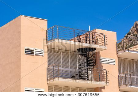 Summer Villa With Stairs On The Balcony. A Typical Spanish Style Building On Street Of Port De Polle