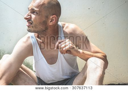 Homeless Man, Young Poor Skinny Anorexic Bald Homeless Man Sitting On The Urban Street In The City O