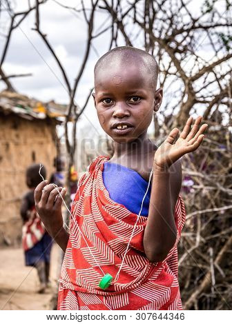 Masai Village, Kenya - October 11, 2018: Unindentified African Child Wearing Traditional Clothes In