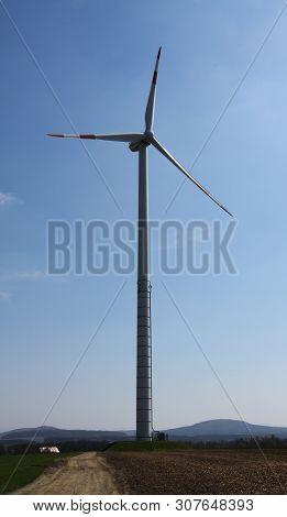 Windmills Of A Windfarm In The Field